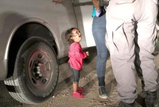 Honduran two-years-old girl sobbing at the U s border as police search her mother